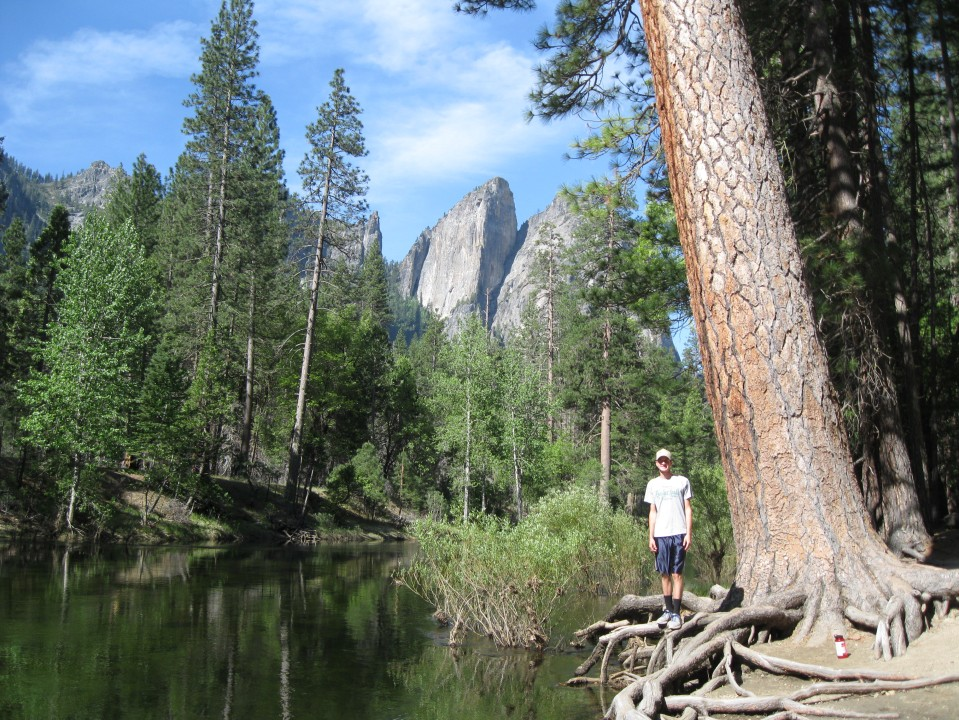 Andrew by the Merced River with Cathedral Rocks in the background.