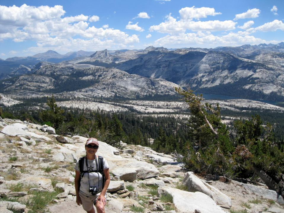Climbing higher.  The blue of Tenaya Lake is visible on the left.
