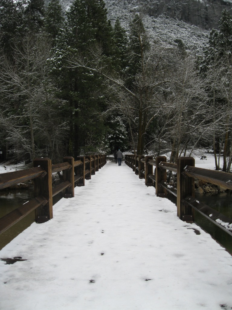 Walking across Swinging Bridge.