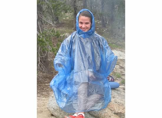 Julia's answer to the biting mosquitos, don the rain poncho.