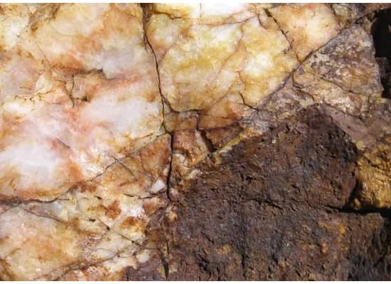 Copper-colored rock.