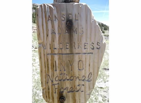 Trailhead sign at the border.