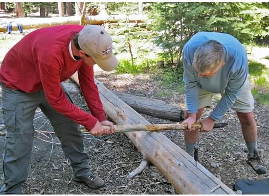 Here both Chris and Andrew work together.  The log actually started to smoke.