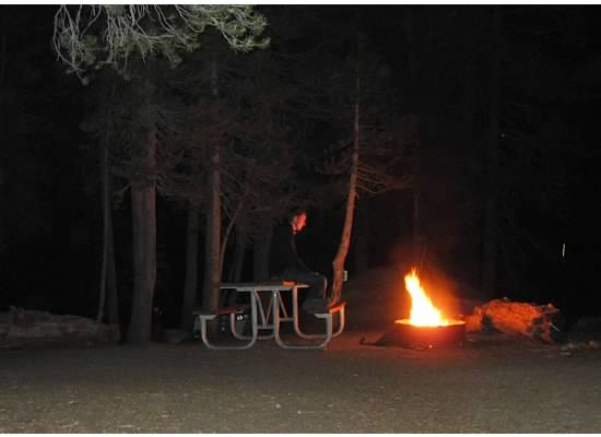 Contemplating by the campfire after dinner.